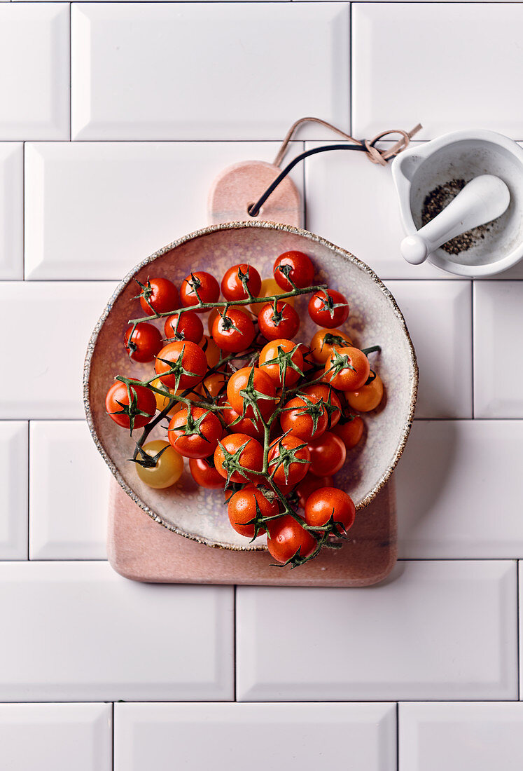 Cocktail tomatoes in a ceramic bowl