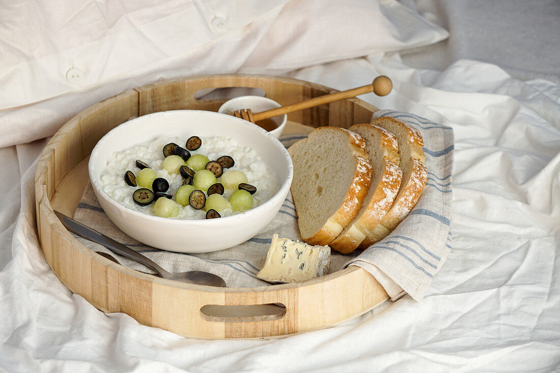 Porridge with fruits - breakfast tray in bed