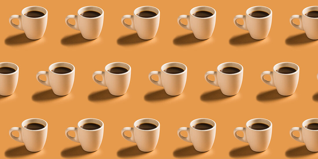 Many cups of hot coffee in rows