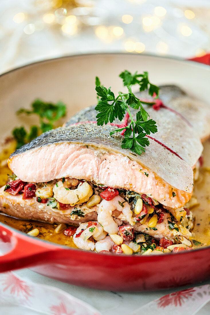 Salmon fillet filled with prawns, bell peppers and pine nuts
