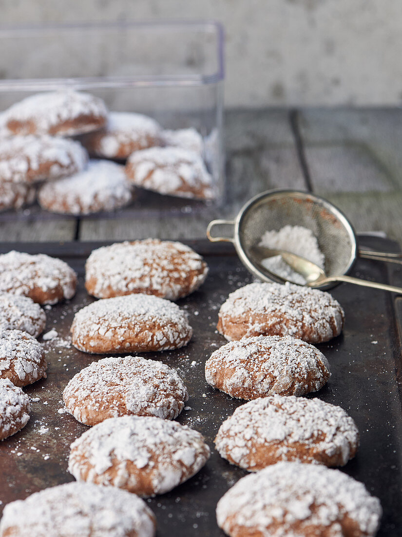 Baked cinnamon balls with powdered sugar
