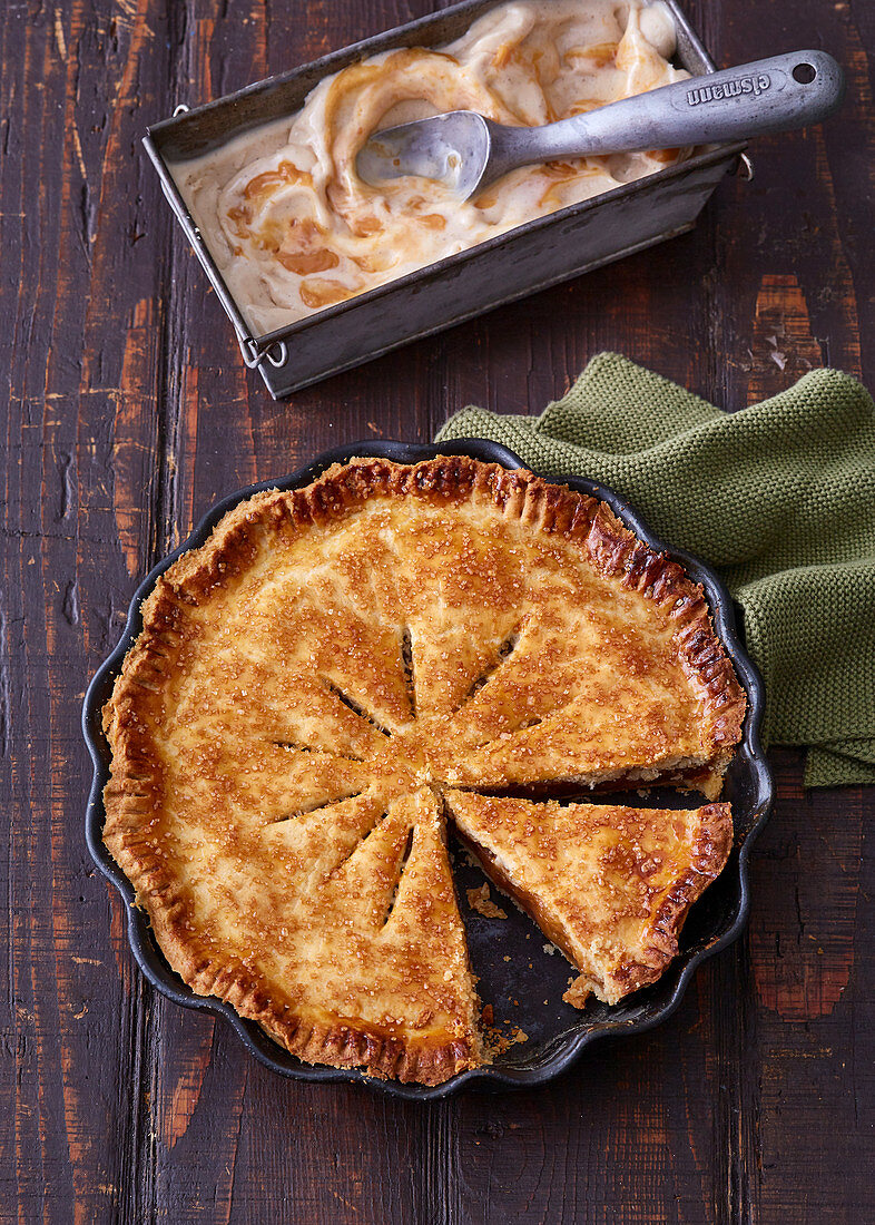 Apple pie in a pie dish with tahini ice cream