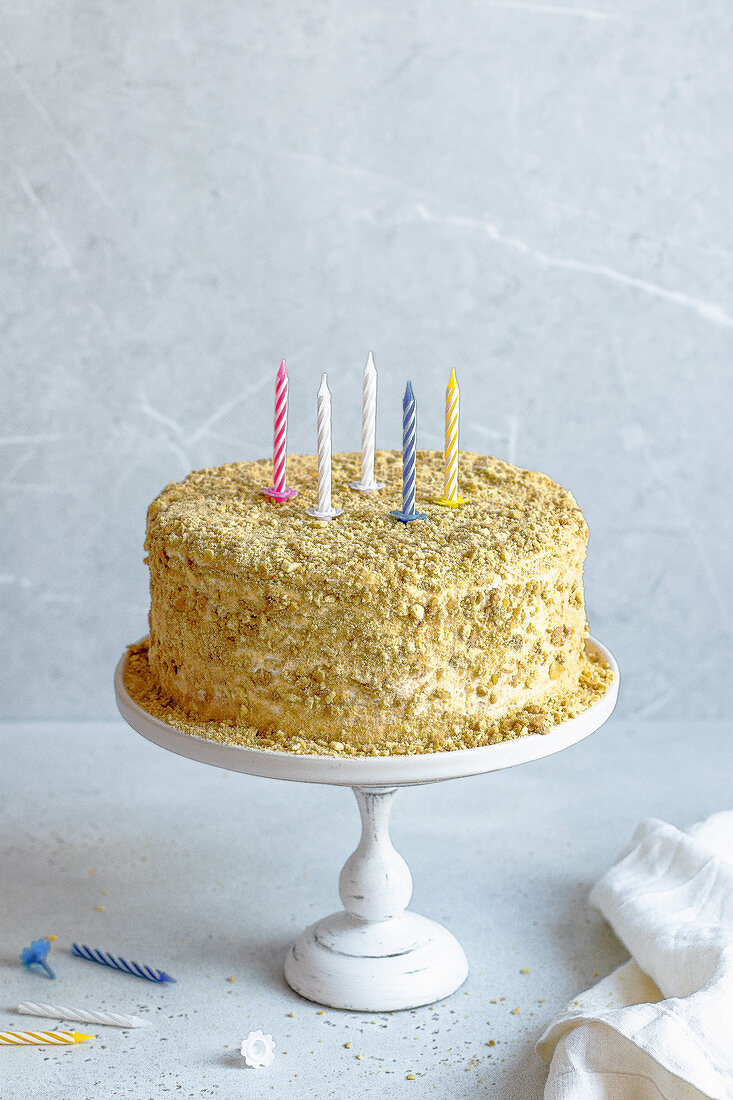 Honey cake with candles for birthday