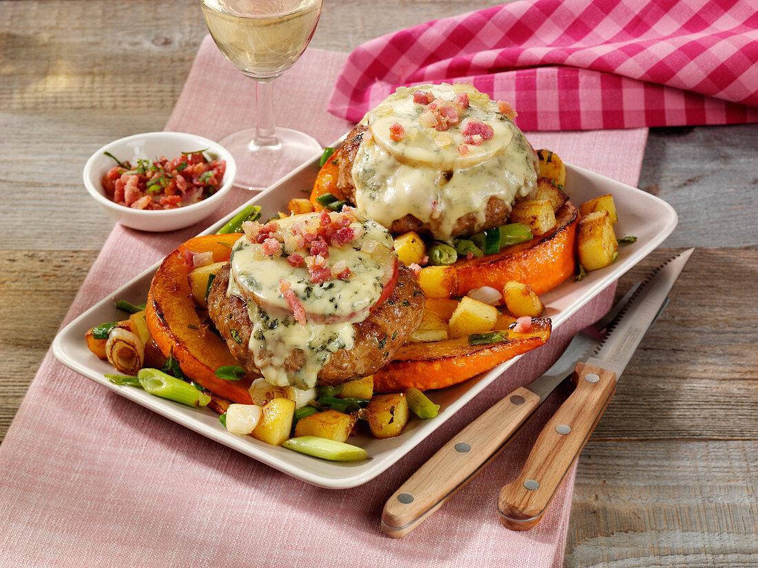 Meatballs au gratin with cheese on pumpkin-potato-vegetables