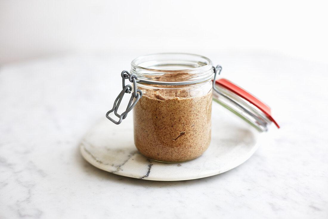 Homemade almond butter in a flip-top jar