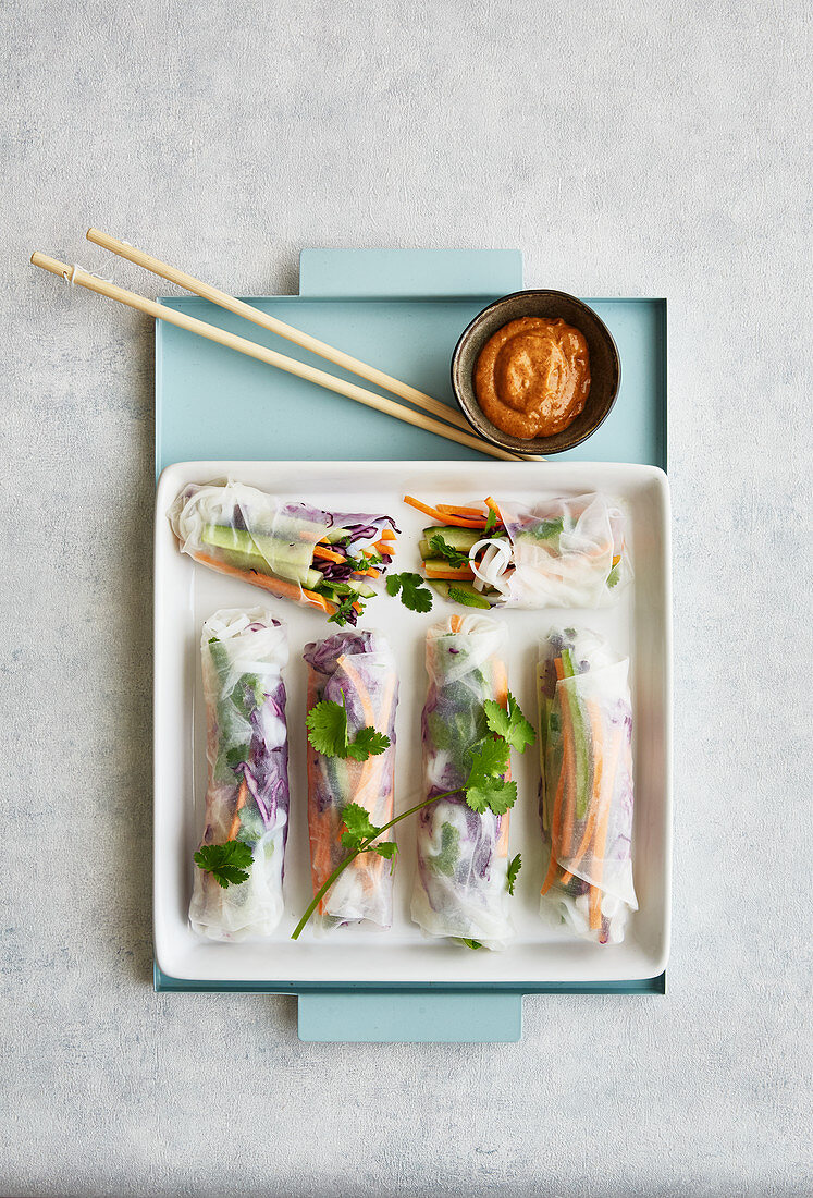 Colourful summer rolls with an almond and chilli dip