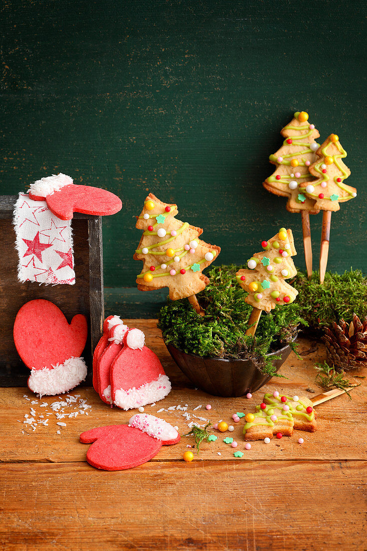 Red motif biscuits (glove, cap) and fir trees on a stick