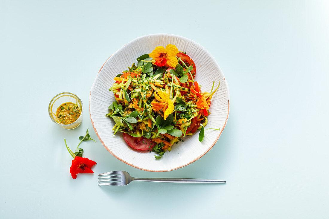 Flowering summer purslane salad with hemp seeds