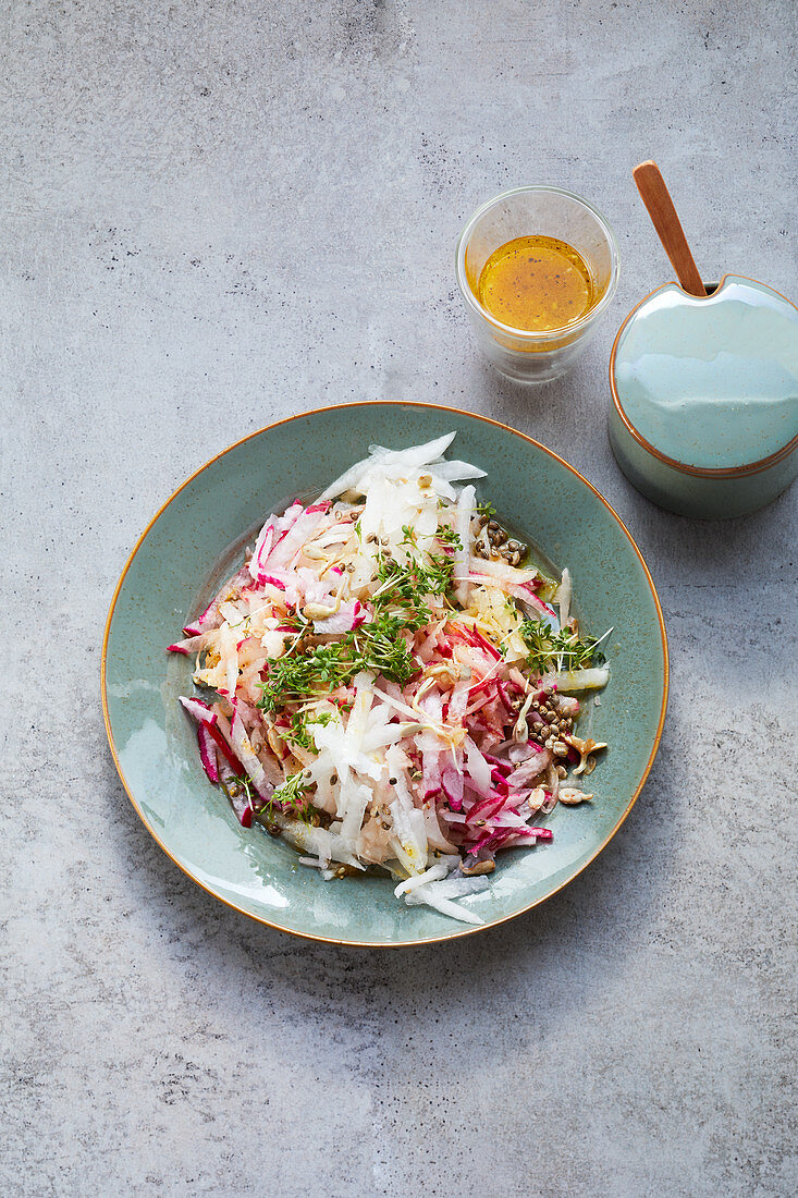 Red radish salad with sunflower seeds and flaxseed oil