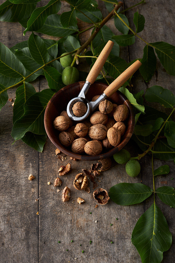 Walnuts in a wooden bowl with a nutcracker