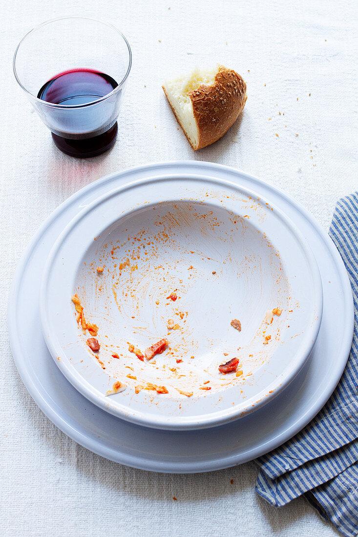 An empty plate of spaghetti al'amatriciana