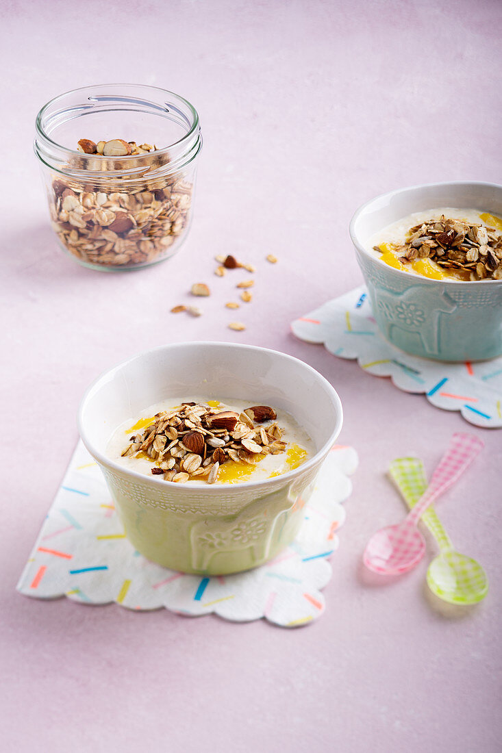 Mango and yogurt muesli with almonds and sunflower seeds