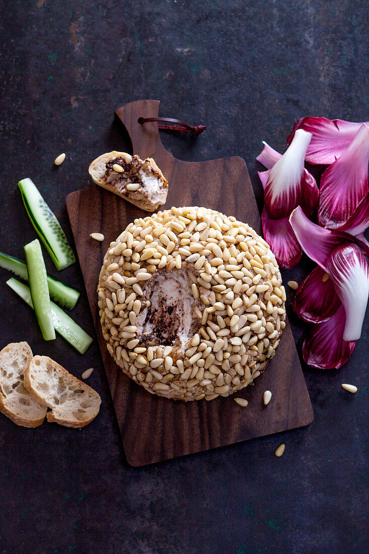 Cheese ball with pine nuts and tuna tapenade