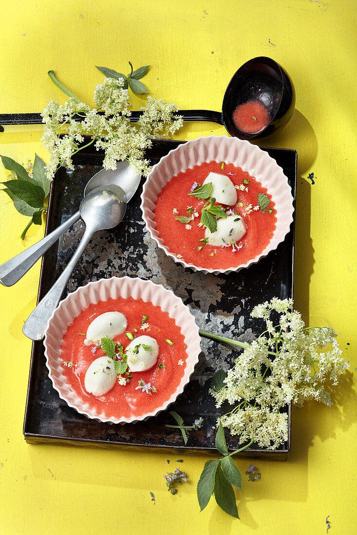 Iced elderberry and strawberry soup with tonka yoghurt dumplings