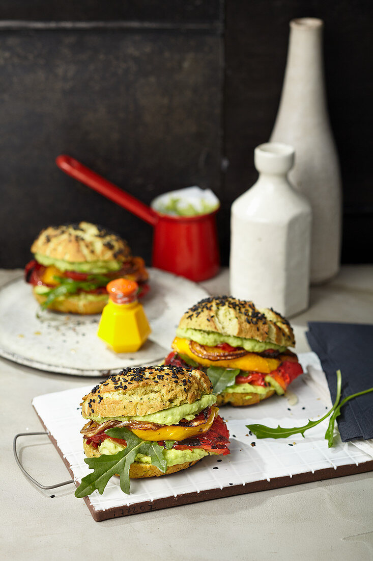 Vegan pepper burger with tomatoes and avocado