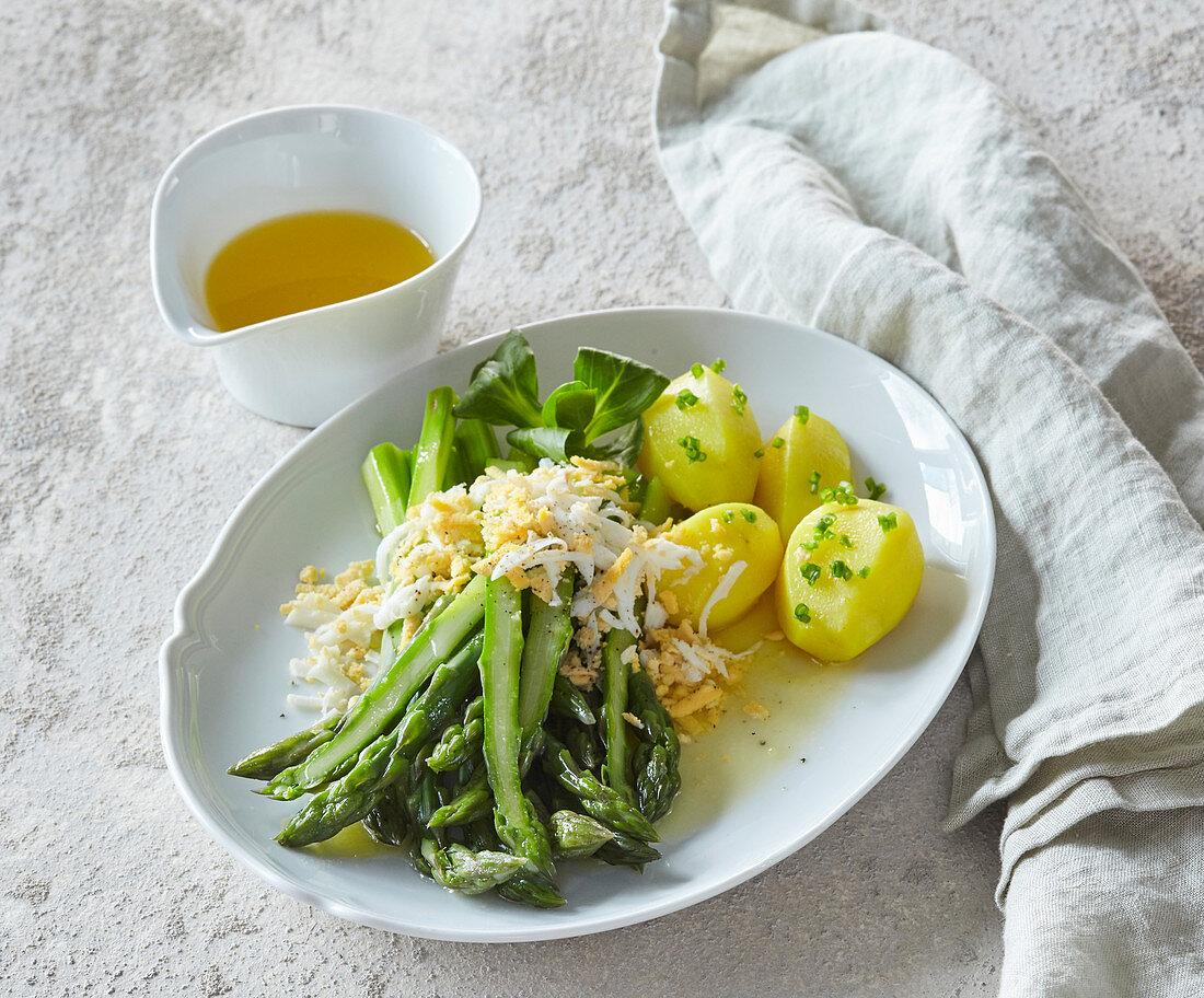 Green asparagus with concetrated butter and boiled egg