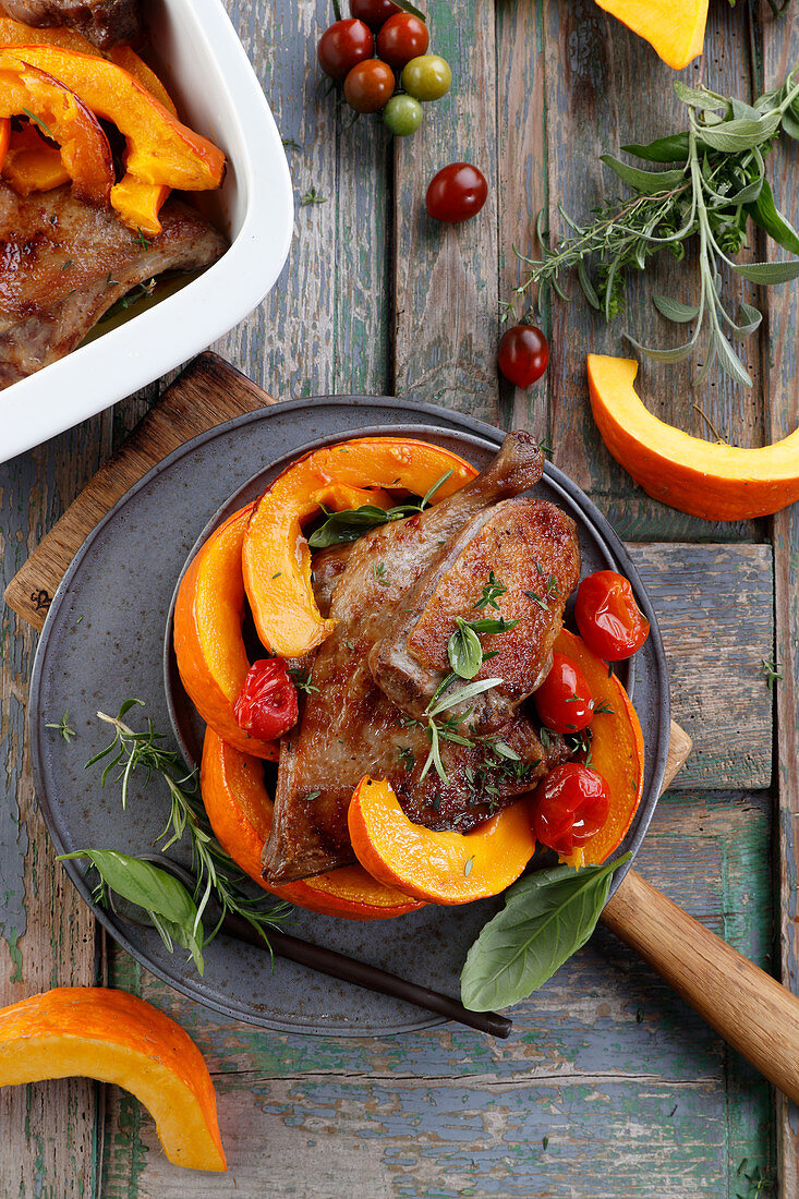 Duck in herbs roasted with pumpkin
