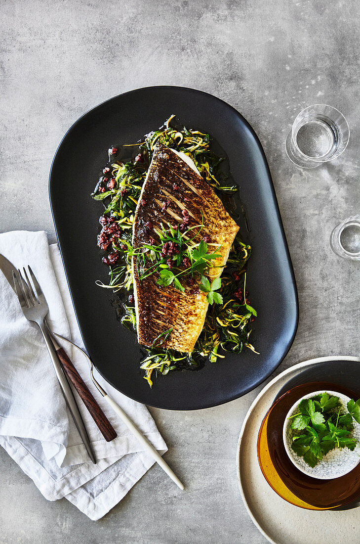 Grilled Murray cod with spring onions and olives