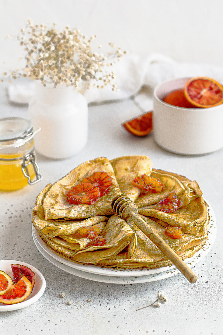 Crepes with blood oranges and honey