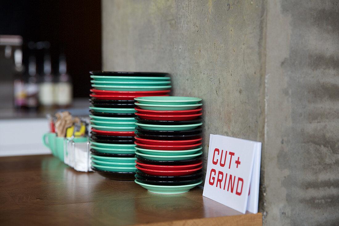 Coloured plastic plates in restaurant