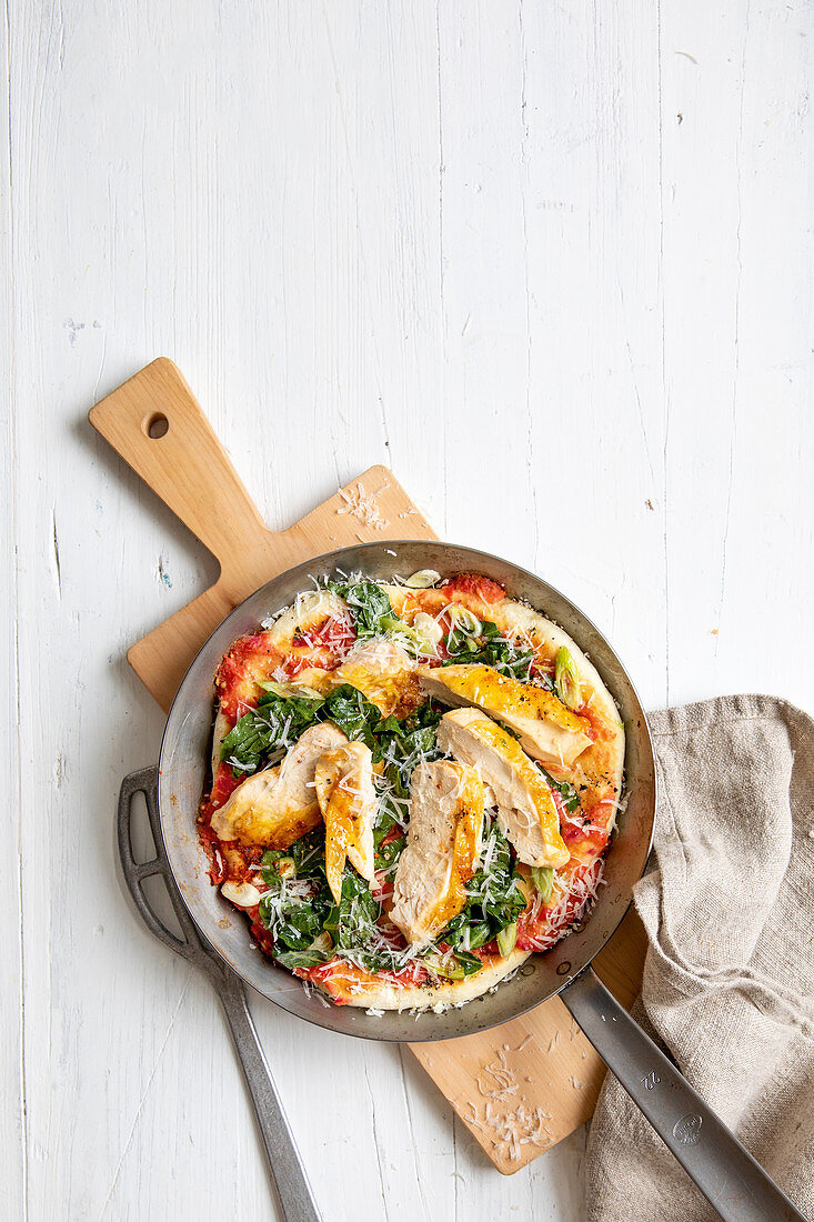 Pan-fried pizza with chicken breast
