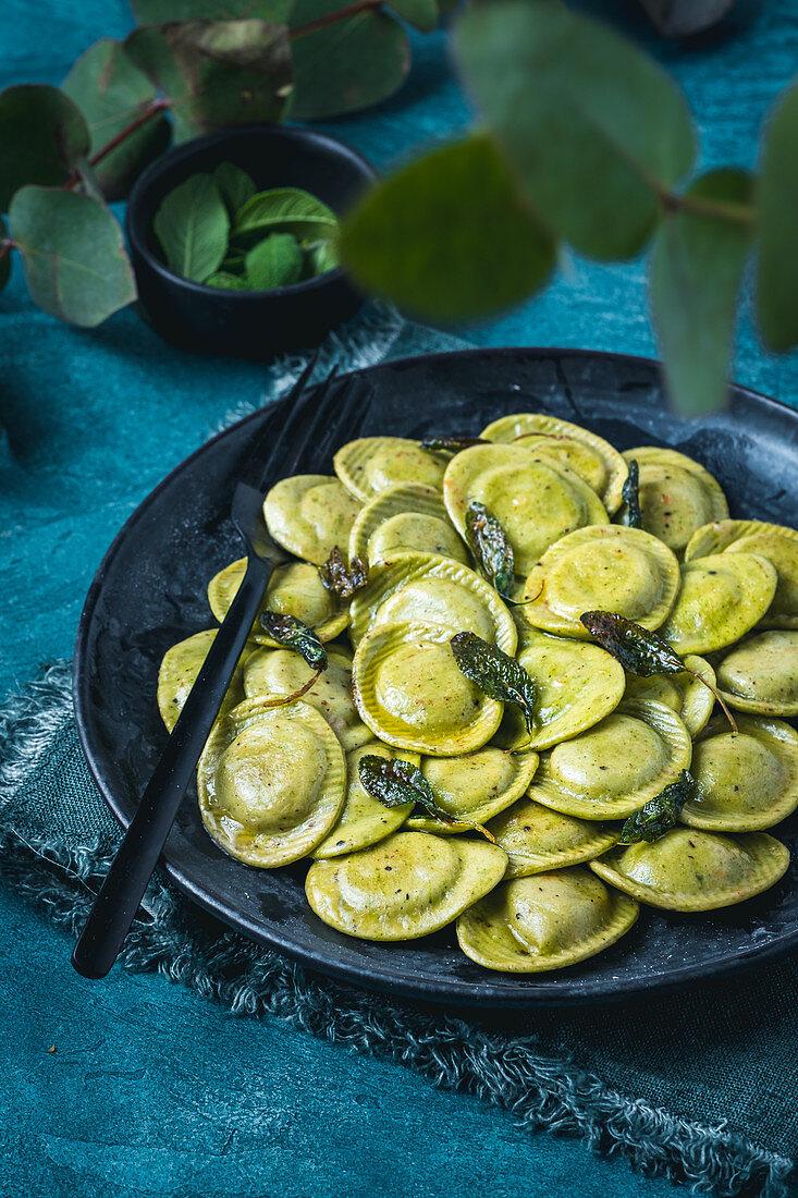 Mint and potato ravioli with sage