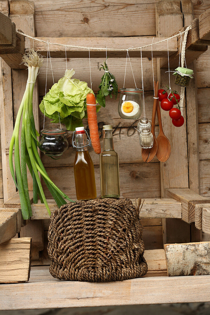 Ingredients for colourful salad hanging from string