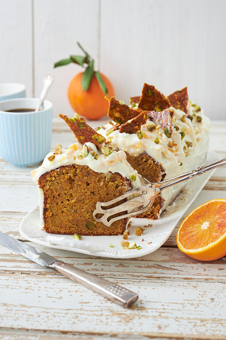Orange and carrot loaf cake with pistachio nuts