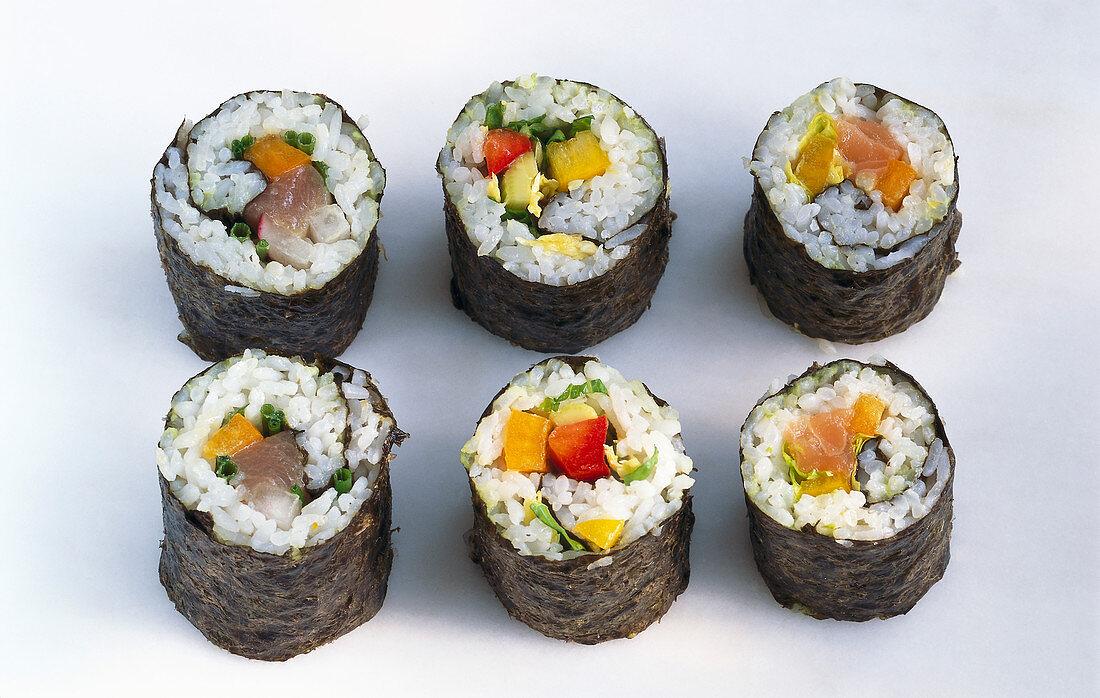 Six maki sushi, on a light background