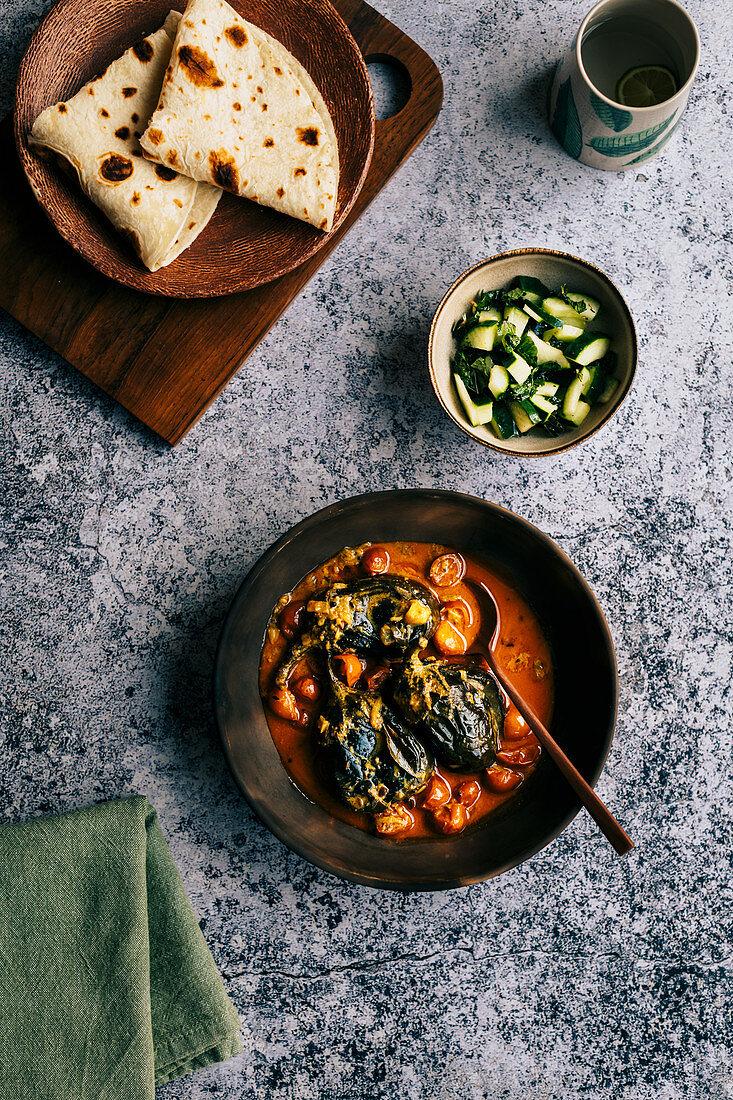 Baby aubergine curry with roti and cucumber sambal