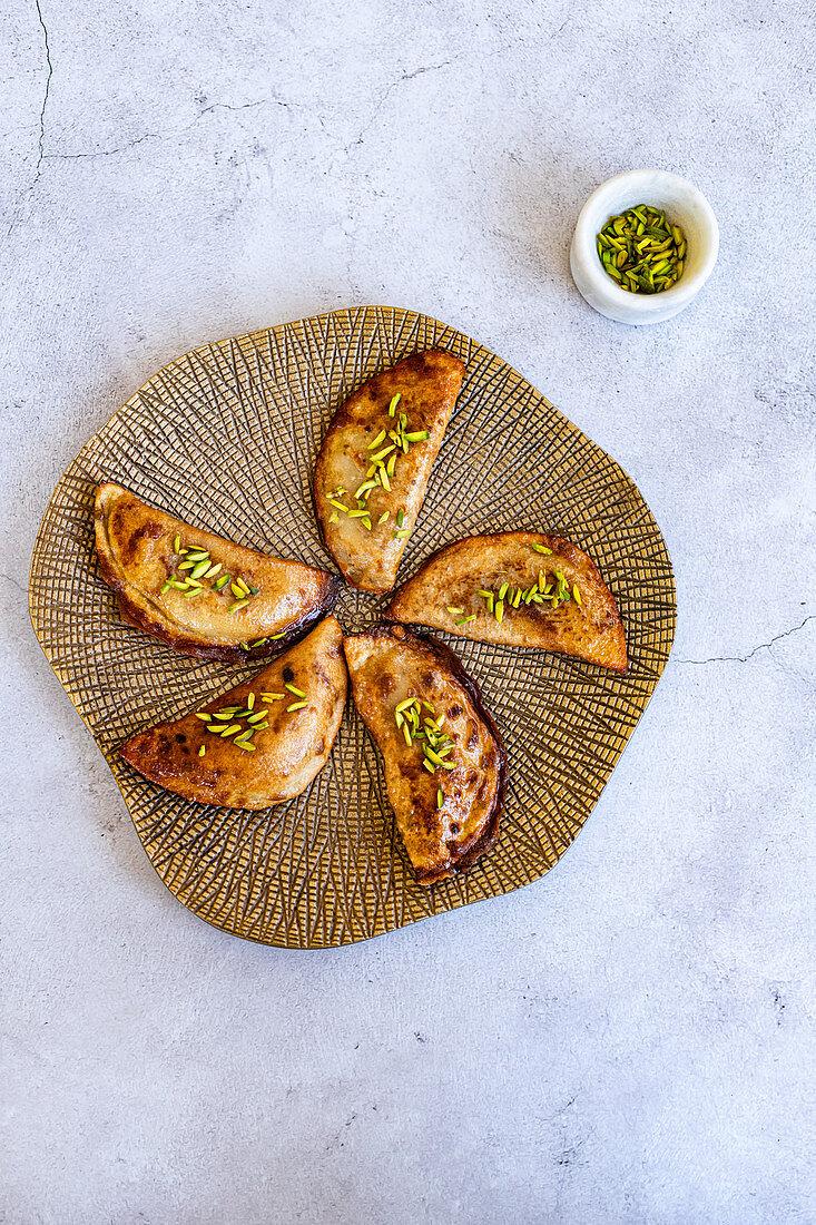 Qatayef - arabian yeasted pancake filled with cream or nuts for ramadan