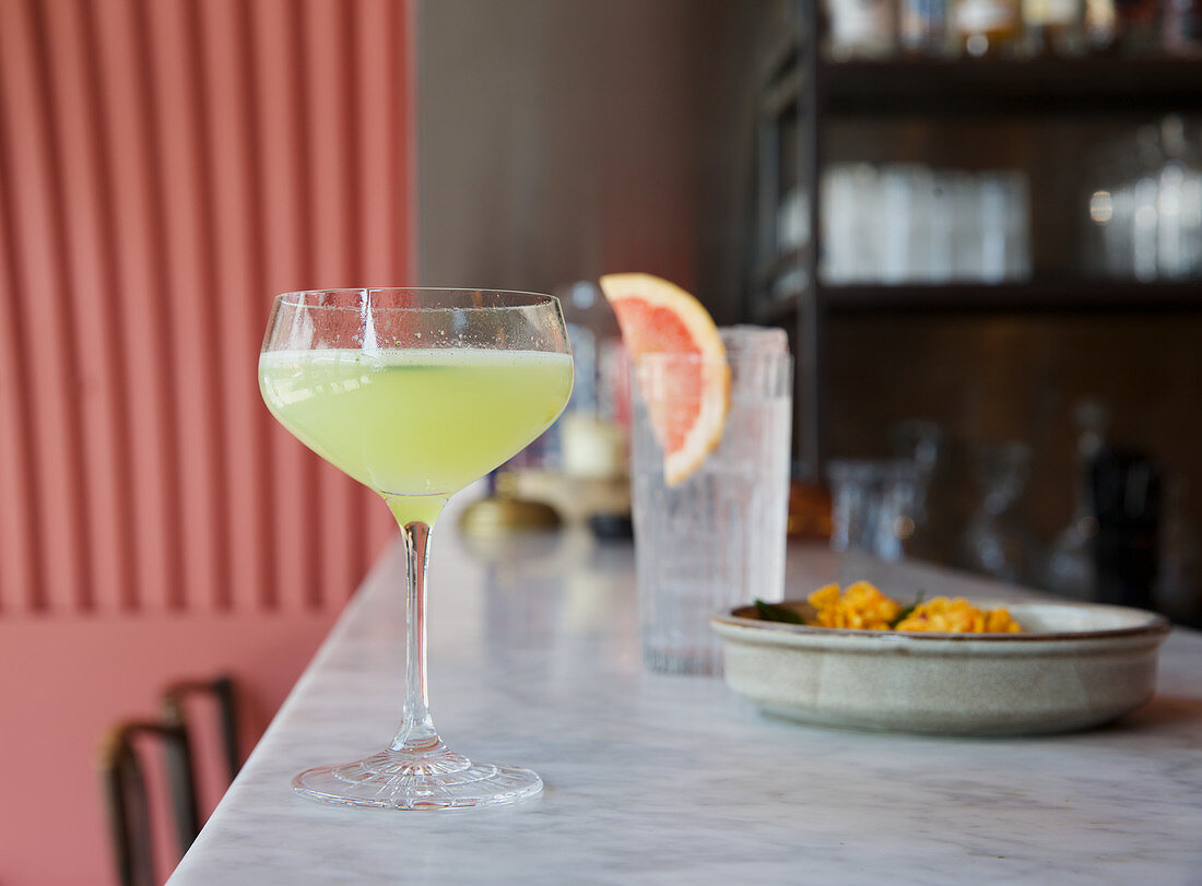 Lucky Neem cocktail on a bar countertop