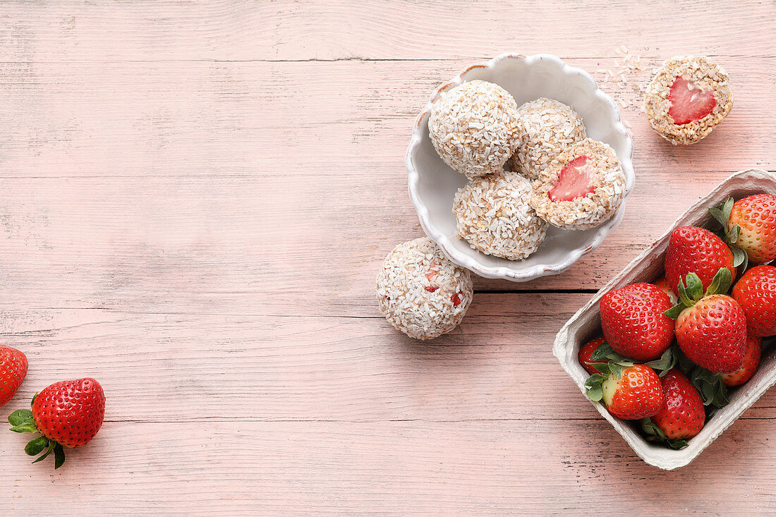 Vegan strawberry balls with Medjool dates, desiccated coconut and puffed amaranth