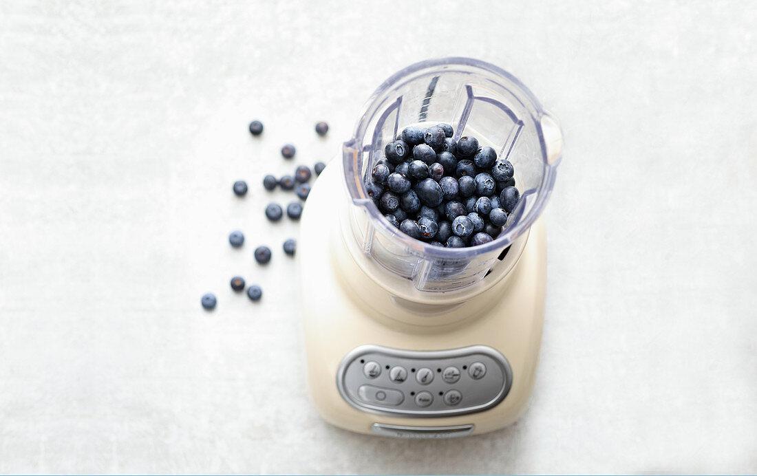 Fresh blueberries in a blender
