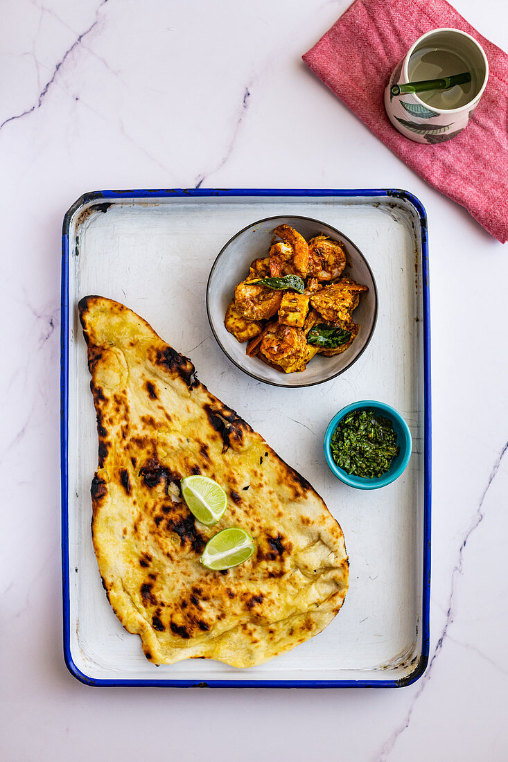 Prawn paneer curry with butter naan and fresh chutney