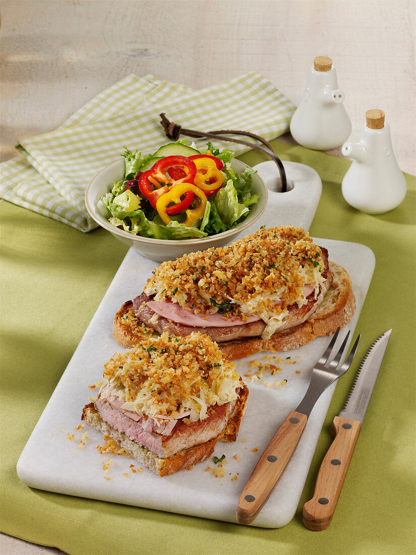 Schnitzel bread with cheese and sauerkraut topping