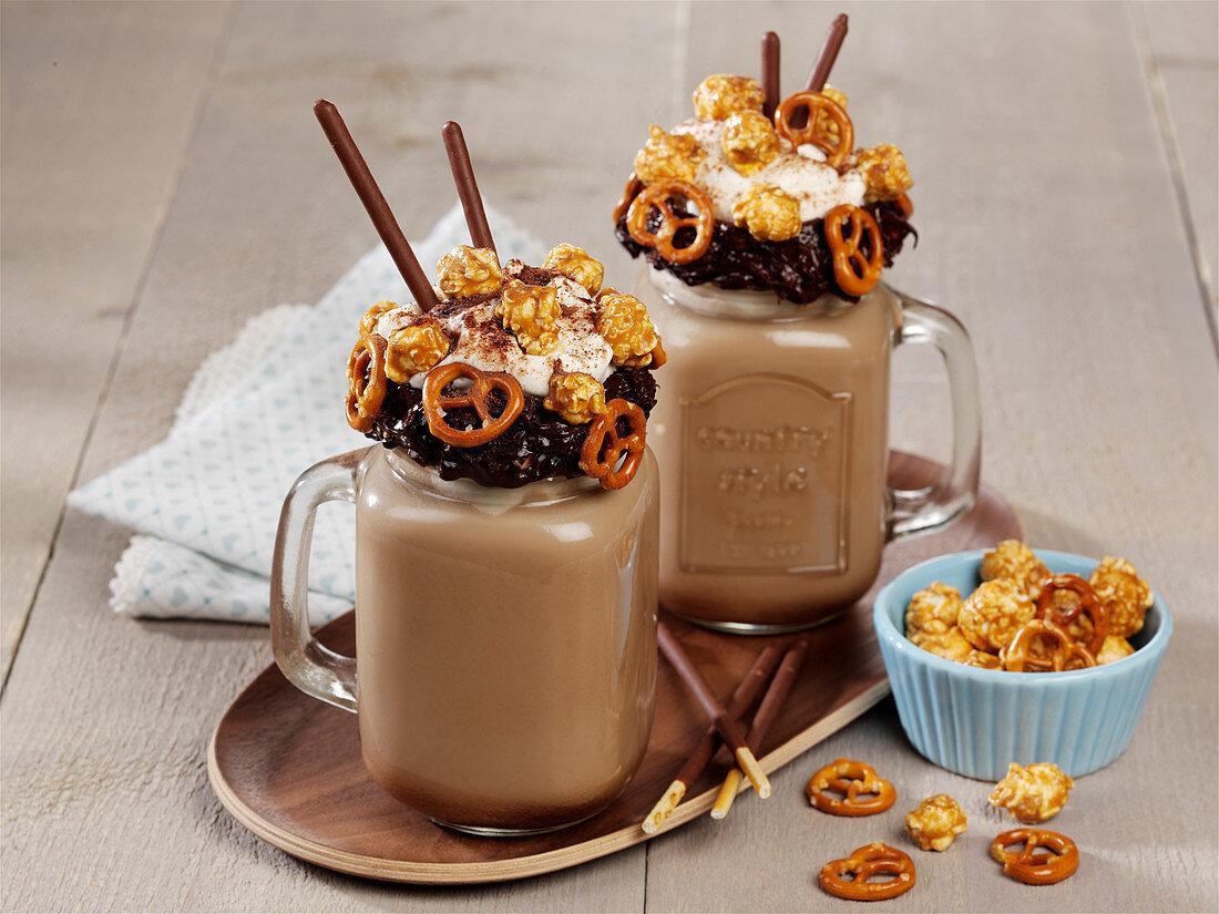 Peanut chocolate shake with popcorn, pretzels and caramel sauce