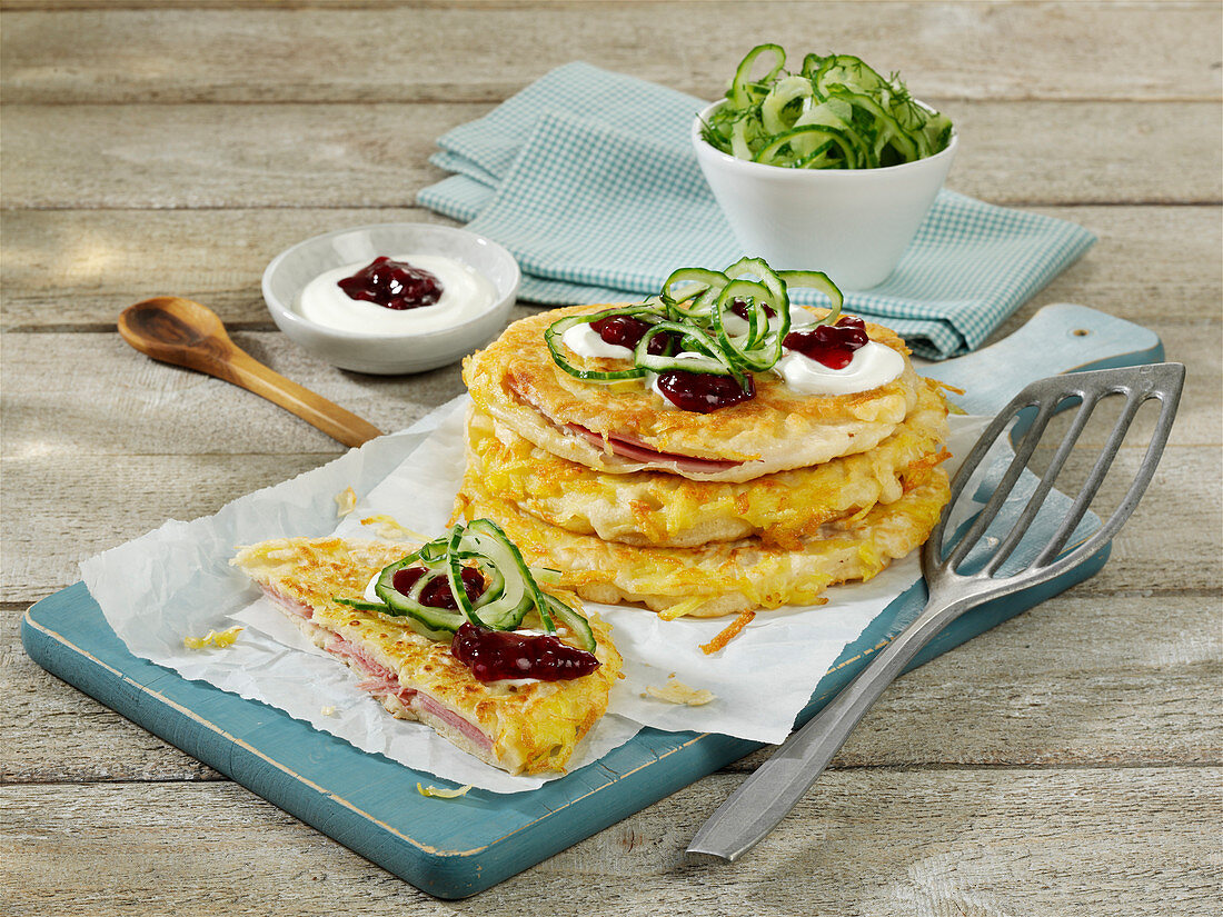 Hearty potato pancakes with ham and cranberries