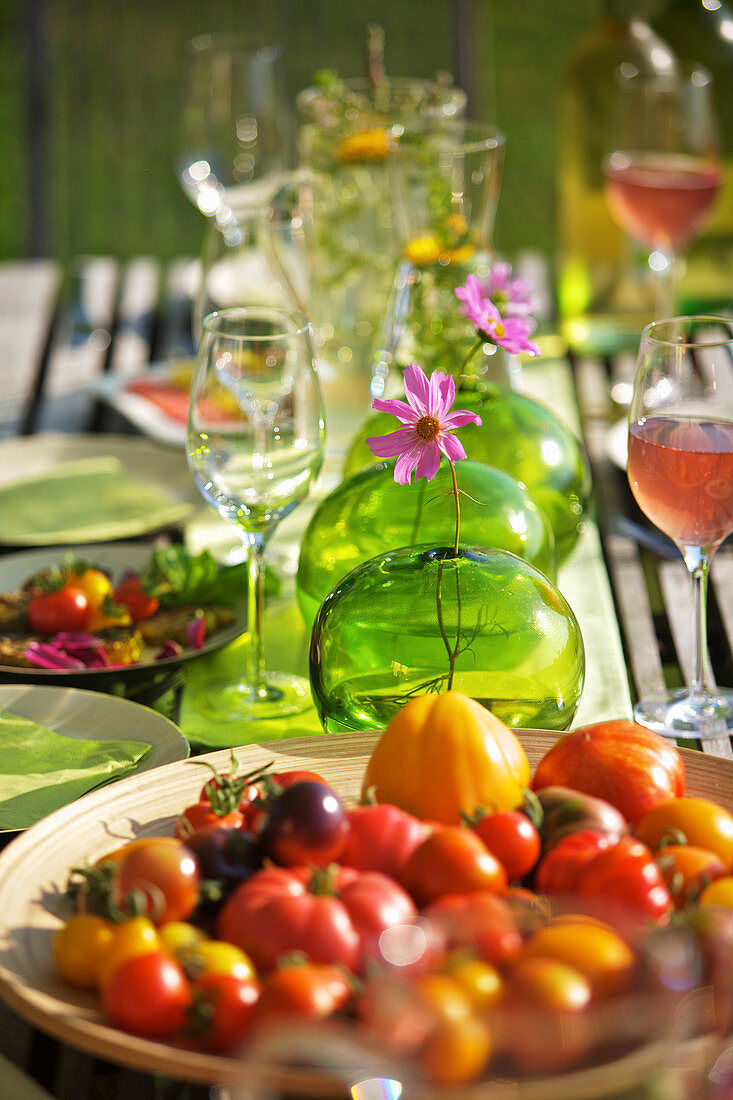 Various fresh tomatoes on a summer garden table