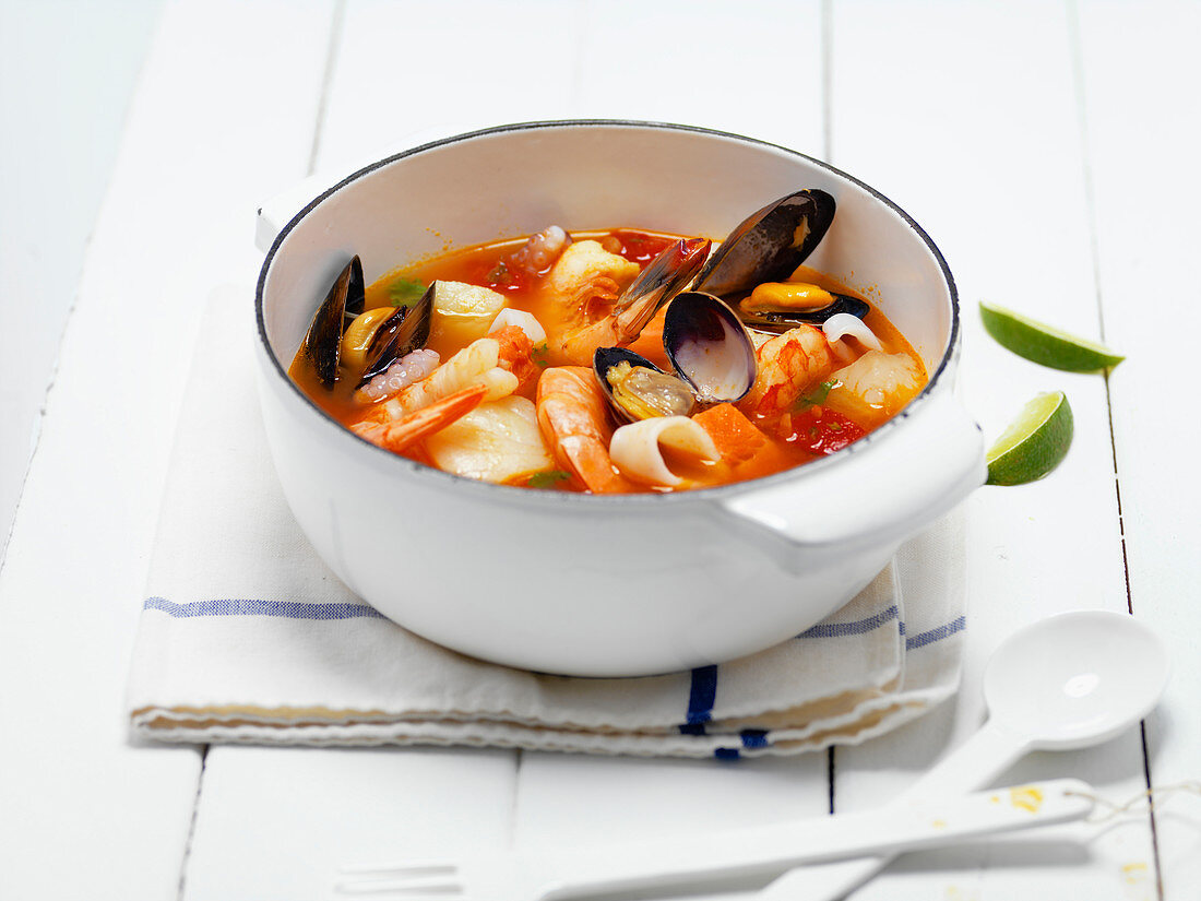 Seafood Stew In White Enameled Casserole Dish