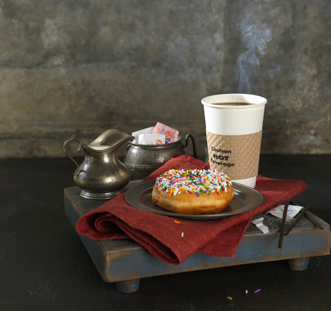 Sprinkle Donut On Silver Plate with Takeout Coffee, Cream and Sugar