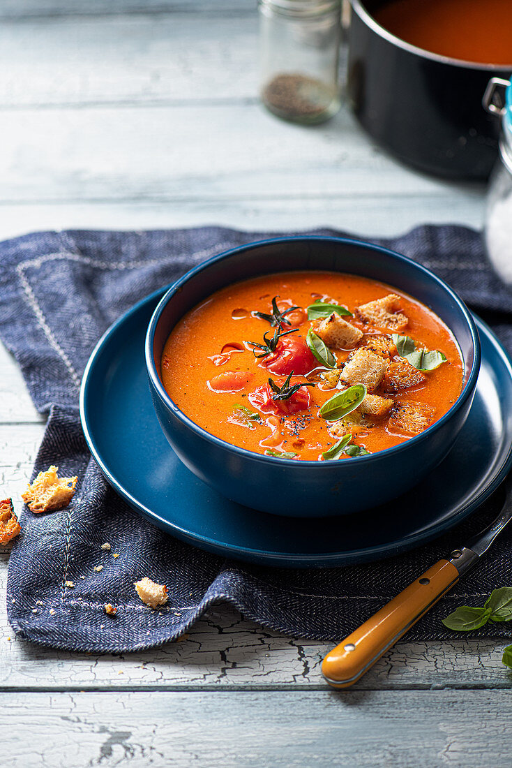 Roasted tomato soup with sour dough croutons, basil and olive oil