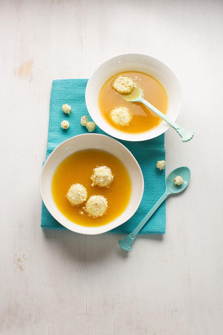 Peach cold broth with popcorn quark balls