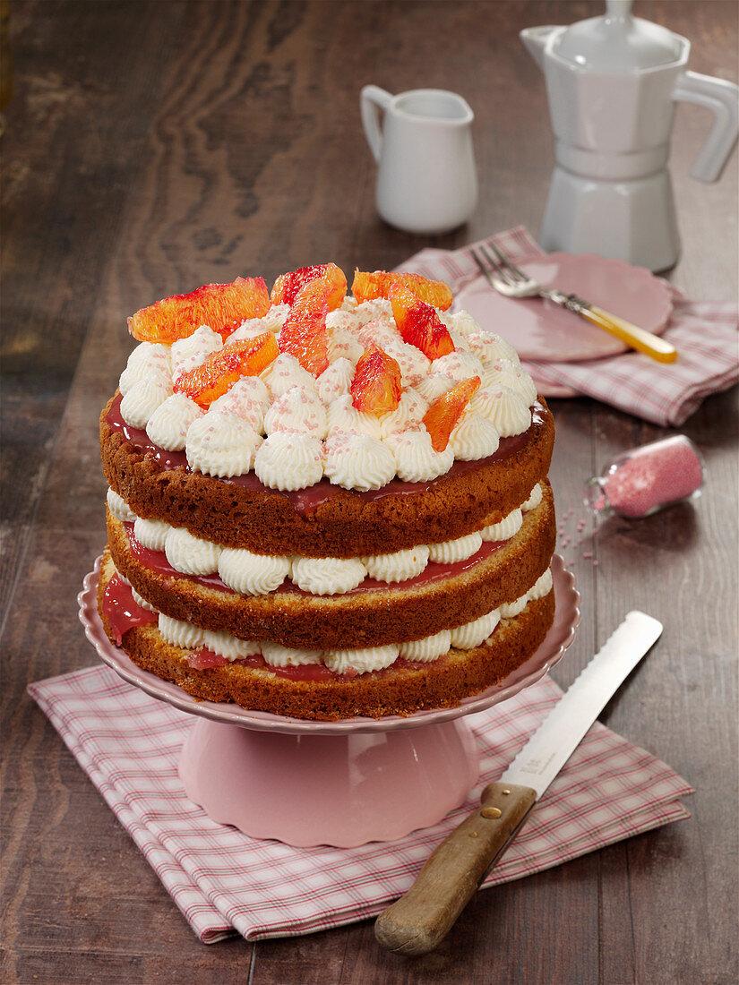 Small blood orange cake with cream and quark cream