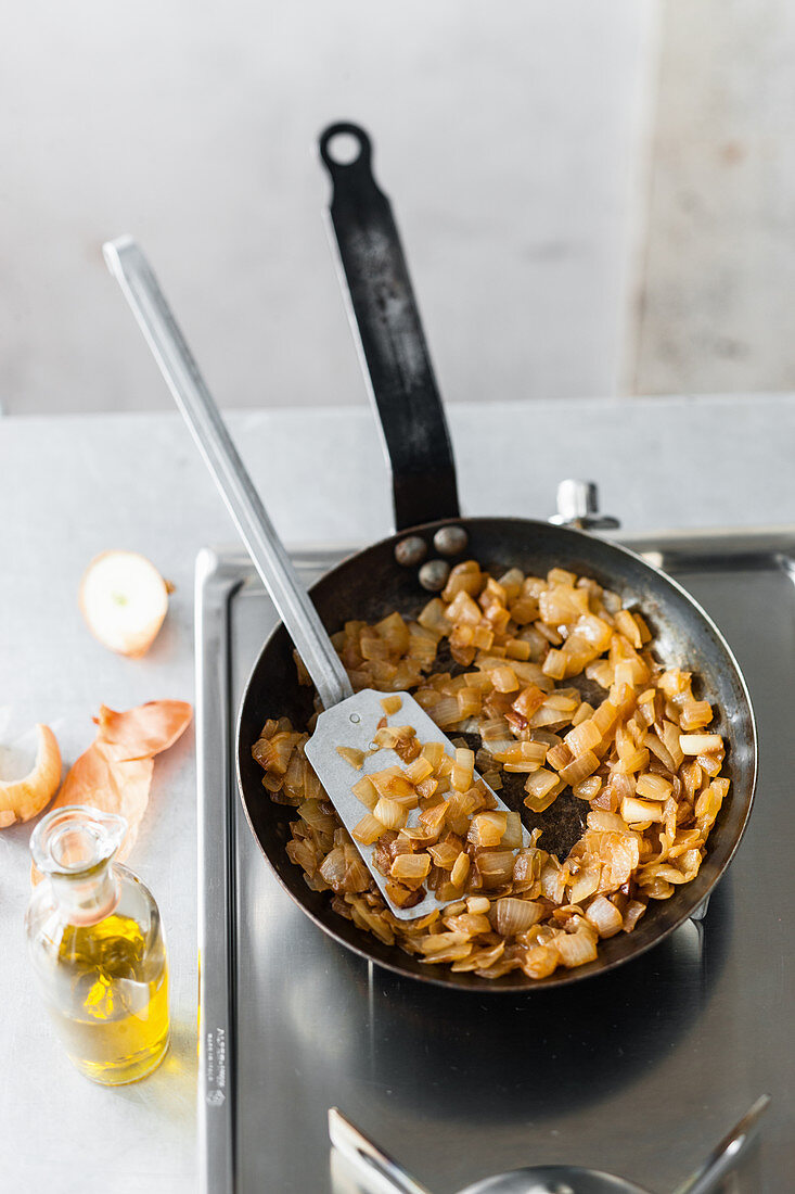 Braised onions in a pan
