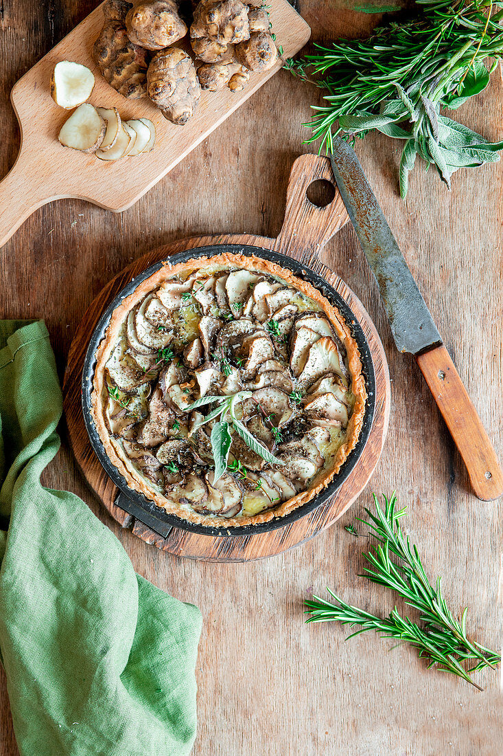 Jerusalem artichoke pie with cheese filling and herbs