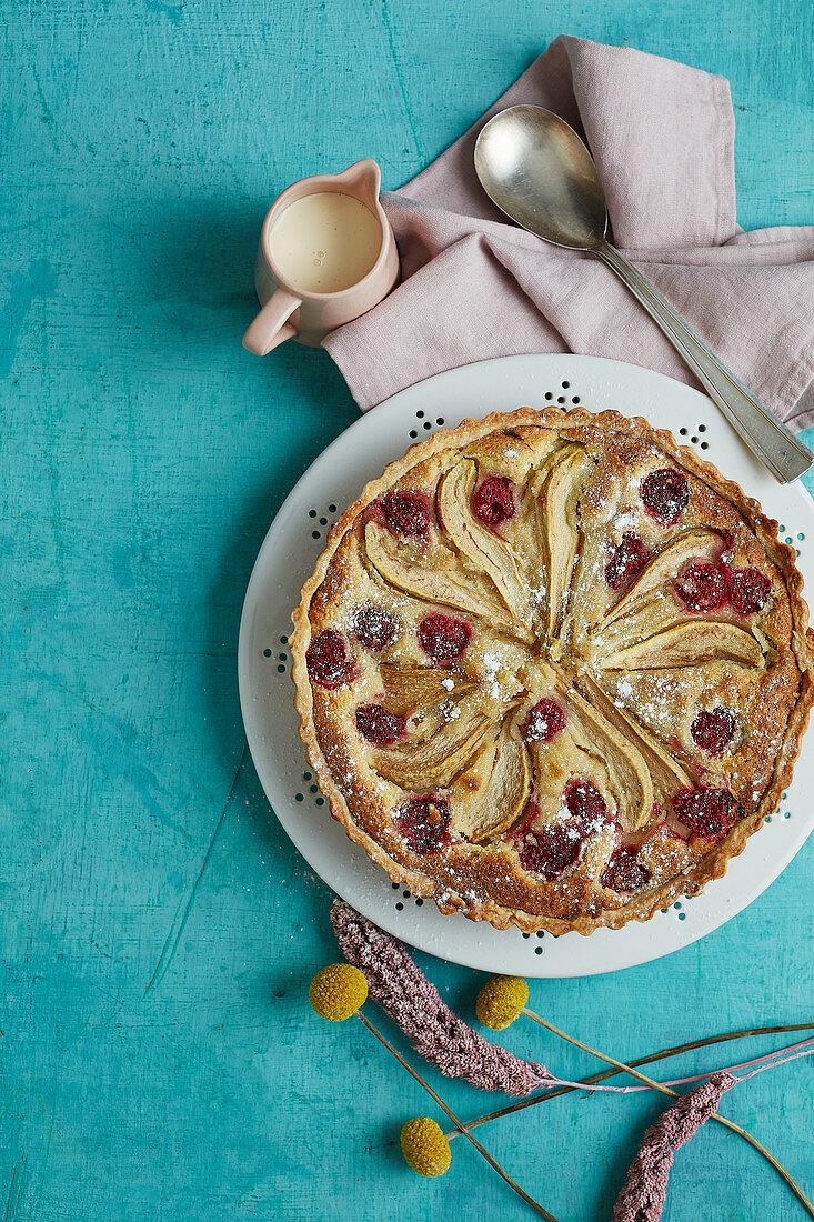 Pear and raspberry frangipane tart with cream