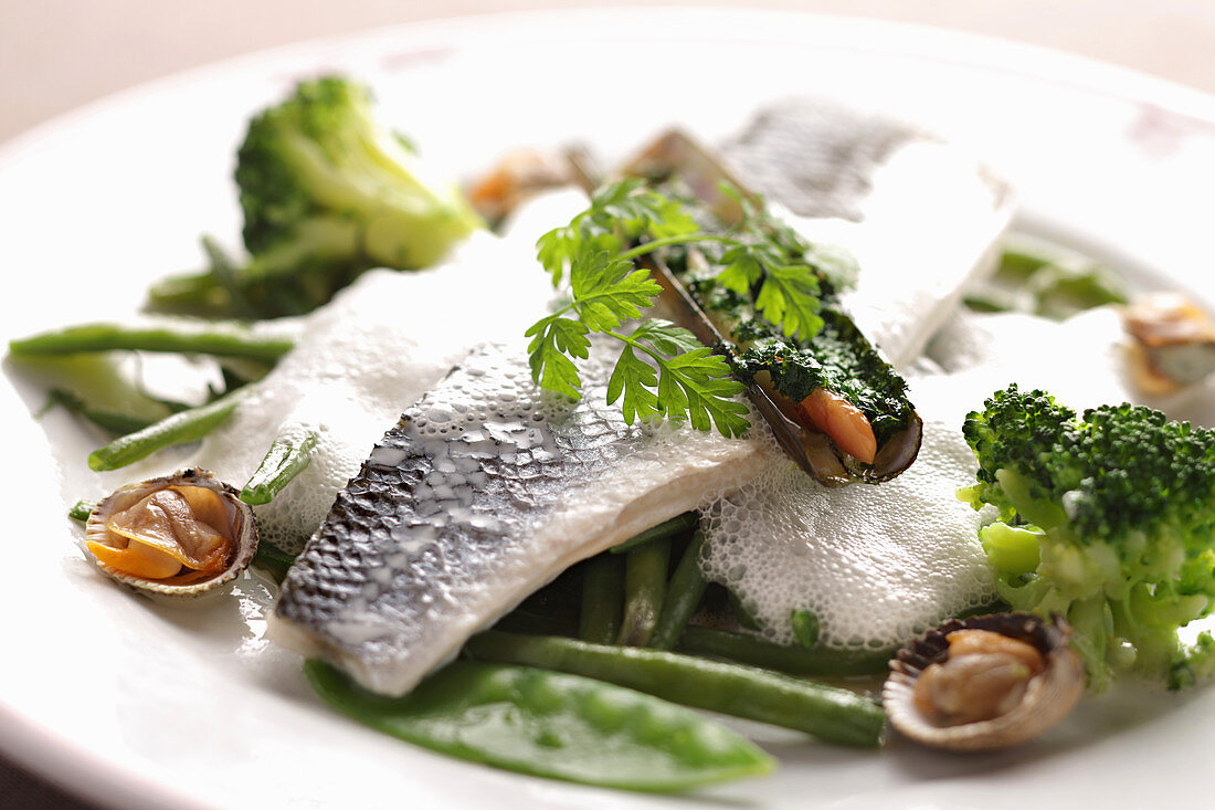 Seafood plate with green vegetables