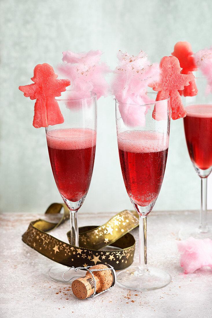 Kir Royal with grenadine, sparkling wine and fruit decoration