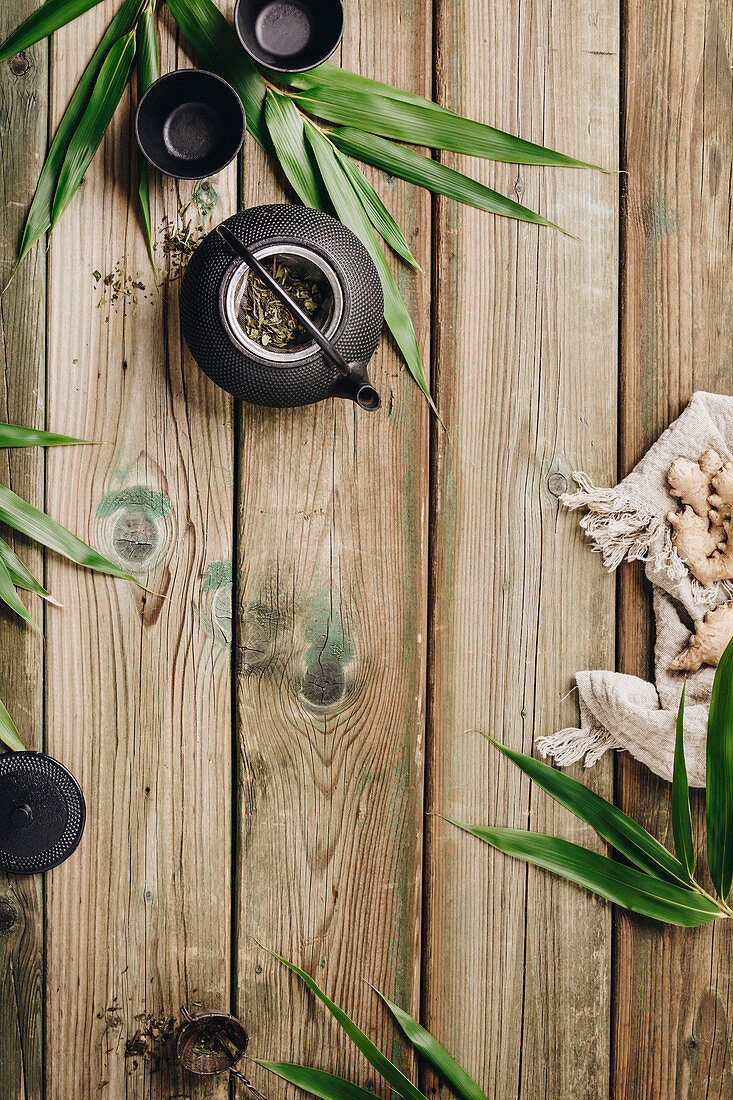 Ginger tea and ingredients on wooden surface